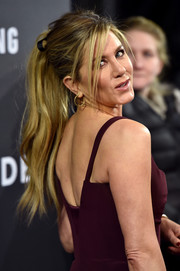 Jennifer Aniston rocked a messy ponytail at the world premiere of 'Zoolander 2.'