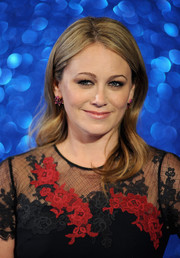 Christine Taylor opted for a simple wavy hairstyle when she attended the 'Zoolander No. 2' London fan screening.