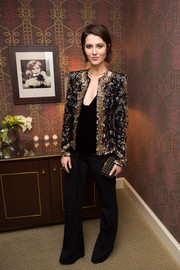 Mary Elizabeth Winstead styled her look with an elegant studded clutch.