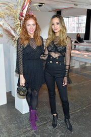 Jamie Chung teamed high-waisted skinny pants with a sheer top for the alice McCall fashion show.