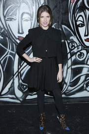 Anna Kendrick was all about old-school elegance in a bow-adorned black skirt suit during the Alice + Olivia presentation.