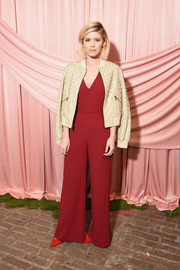 Kate Mara looked Valentine-ready in a red V-neck jumpsuit while attending the Alice + Olivia Fall 2017 presentation.