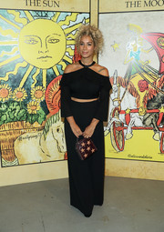 Leona Lewis stayed on trend in a black cold-shoulder crop-top at the Alice + Olivia fashion show.