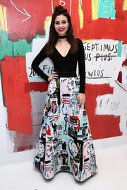 Victoria Justice spiced up her plain top with a graphic-print maxi skirt.