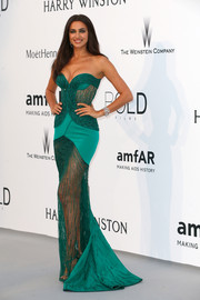 Irina Shayk was her usual seductive self in a crystal-studded, sheer green strapless gown by Atelier Versace during the amfAR Cinema Against AIDS Gala.