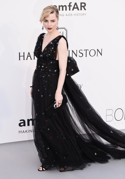 Melissa George looked gorgeous at the amfAR Cinema Against AIDS Gala in a black Schiaparelli Couture tulle gown embellished with colorful stars.