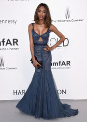 Jourdan Dunn put her curves on display in a low-cut blue Vera Wang mermaid gown with peekaboo detailing during the amfAR Cinema Against AIDS Gala.