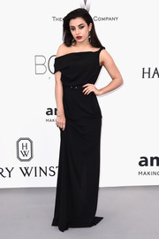 Charli XCX looked downright elegant in an asymmetrical black off-the-shoulder gown by Vivienne Westwood Red Label at the amfAR Cinema Against AIDS Gala.
