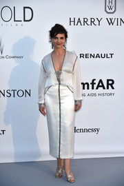 Juliette Binoche looked very classy in a white Chanel Haute Couture tea-length dress, featuring a slouchy bodice and metallic piping, at the amfAR Cinema Against AIDS Gala.