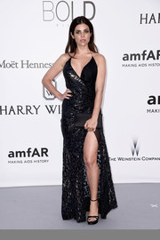 Julia Restoin-Roitfeld cut a shapely silhouette in this dual-textured black halter gown at the amfAR Cinema Against AIDS Gala.