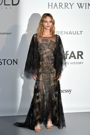 Vanessa Paradis chose a sheer, square-patterned gown by Chanel Haute Couture, featuring a layered hem and sleeves, for the amfAR Cinema Against AIDS Gala.