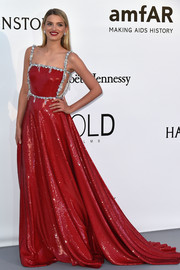 Lily Donaldson looked absolutely stunning at the amfAR Cinema Against AIDS Gala in a crimson Miu Miu sequin gown with crystal embellishments.