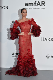 Katy Perry looked gorgeous (with a capital G!) in this petal-appliqued red off-the-shoulder gown by Marchesa at the amfAR Cinema Against AIDS Gala.