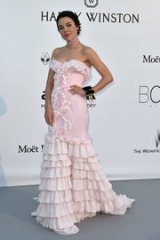 Ulyana Sergeenko went ultra sweet in a mega-ruffled pink strapless gown from her own label at the amfAR Cinema Against AIDS Gala.