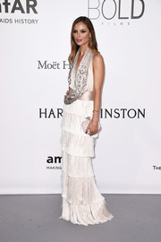 Georgina Chapman was flapper-glam in a halter gown with a fringed, layered skirt at the amfAR Cinema Against AIDS Gala.
