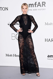 Hailey Clauson commanded stares in a sheer black knit dress by Zuhair Murad at the amfAR Cinema Against AIDS Gala.