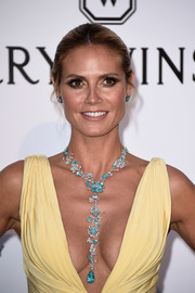 Heidi Klum complemented her decollete dress with a lovely flower-motif gemstone necklace by Lorraine Schwartz during the amfAR Cinema Against AIDS Gala. The necklace and dress made a gorgeous color combo!