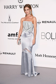 Rosie Huntington-Whiteley went for futuristic glamour in a pale blue Galvan gown with a metallic bodice at the amfAR Cinema Against AIDS Gala.