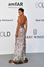 Irina Shayk looked absolutely radiant in an open-back paillette gown by Prada at the amfAR Gala Cannes 2017.