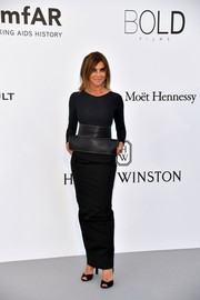 Carine Roitfeld was minimalist in a long-sleeve black Maison Margiela bodysuit paired with a maxi skirt and an oversized belt at the amfAR Gala Cannes 2017.