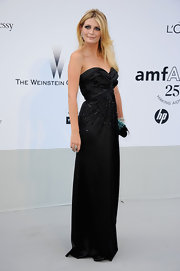 Mischa Barton turned up somewhat unexpectedly at the amfAR gala in a timelessly chic black sweetheart gown. While Mischa still donned her signature dramatic smoky eye, there was something more refined about her look on Wednesday.