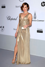 Milla Jovovich is on a fashionable roll and it looks like gold lame has finally been kind to someone. The model turned actress looked stunning in this slick gilded gown by Atelier Versace. To all the other ladies who attempted to tackle the tricky fabric, this is how it's done.