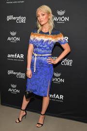 Pom Klementieff styled her dress with basic black sandals.