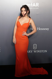 Charli XCX got glam in an orange sweetheart-neckline fishtail gown by Stella McCartney for the amfAR Hong Kong Gala.