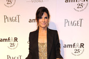 Actress Sandra Bullock attends amfAR's Inspiration Gala at the Chateau Marmont on October 27, 2011 in Los Angeles, California.