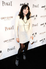 Selma Blair donned a white sweater dress with black tights and glittering ankle-boots for the amfAR Inspiration Gala.