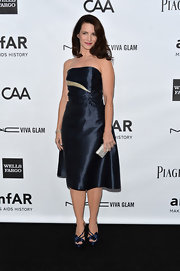 Kristin Davis reminded us of Homecoming in this navy satin flared cocktail dress.