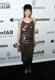 Carly Rae Jepsen attended the amfAR Inspiration Gala wearing a drapey dark-bronze evening dress.