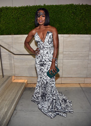 Angela Bassett looked ageless at the amfAR Inspiration Gala in a Michael Costello monochrome strapless gown with a deep-V plunge.