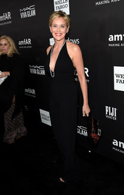Sharon Stone looked as hot as ever in a low-cut black halter jumpsuit during the amfAR Inspiration Los Angeles dinner.