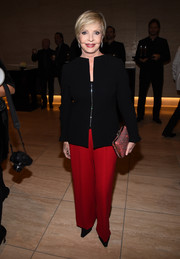 Florence Henderson paired her stylish jacket with red silk pants.