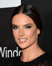 Alessandra Ambrosio opted for a conservative center-parted ponytail when she attended the amfAR Inspiration LA Gala.