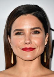 Sophia Bush perked up her beauty look with bold red lipstick.