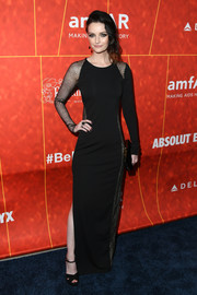 Lydia Hearst went modern in a black sheer-panel column dress by Haney at the amfAR Gala Los Angeles 2018.