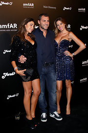 Aida Yespica's beaded blue corset dress made a great show of her cleavage during the 2012 amfAR Milano after-party.