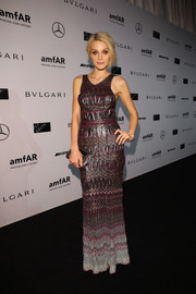 Jessica Stam chose a shiny, patterned column dress by Missoni for the amfAR Milano event.