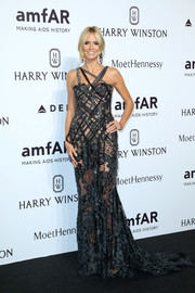 Heidi Klum put plenty of skin on display in a sheer black lace gown by Atelier Versace at the amfAR Milano 2015.