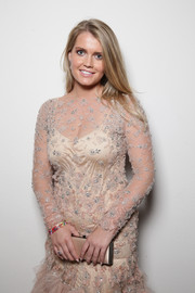 Kitty Spencer matched a satin clutch with her beaded beige gown at the 2015 amfAR Milano Gala.