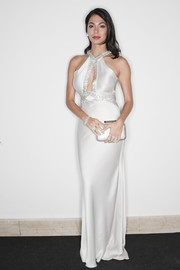 Moran Atias complemented her dress with an elegant silver clutch.