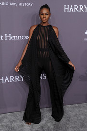 Zuri Tibby looked racy in a sheer black jumpsuit by Balmain at the amfAR New York Gala.