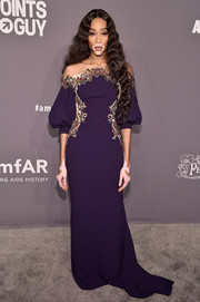 Winnie Harlow made a romantic choice with this beaded purple gown with an illusion neckline for the 2019 amfAR New York Gala.