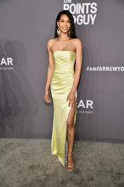 Chanel Iman showed off her slim physique in a strapless yellow column dress by Rasario at the 2019 amfAR New York Gala.