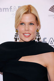 Mary Alice Stephenson paired her elegant evening gown and center part bun with diamond and gemstone earrings.