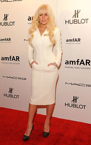 Lindsay Lohan accessorized her fitted white ensemble with sky-high platform pumps.
