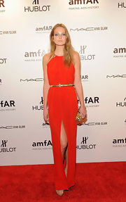 Eniko Mahalik donned an orange '70s-inspired column dress with a  hip-high slit to the amfAR Gala.