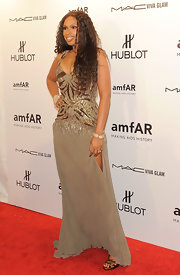Jennifer Hudson wore a shining gown to the amfAR Fashion Week gala.